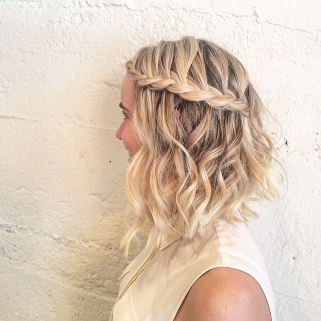 blonde waterfall braid curly lob hair