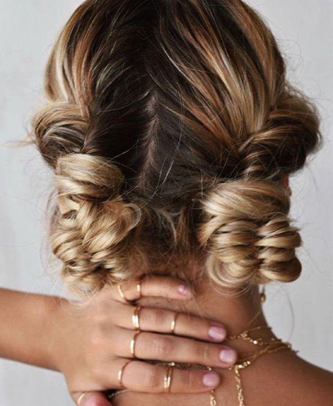 fishtail braid into two buns hair
