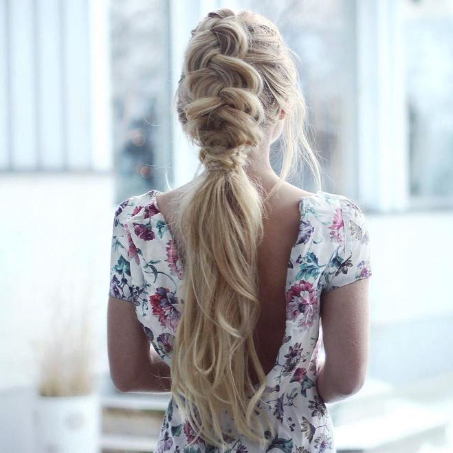 messy dutch braid into low ponytail