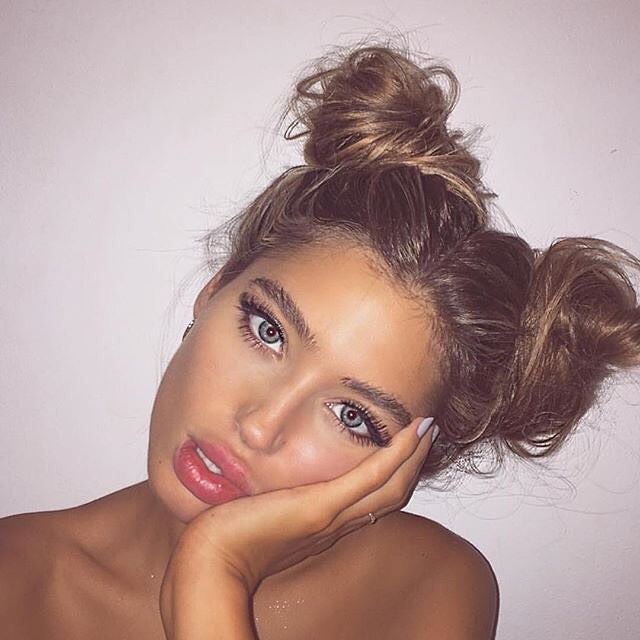 messy twin buns hairstyle