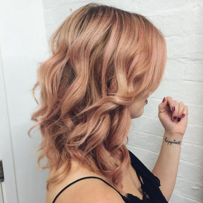 medium curl rose gold hair color